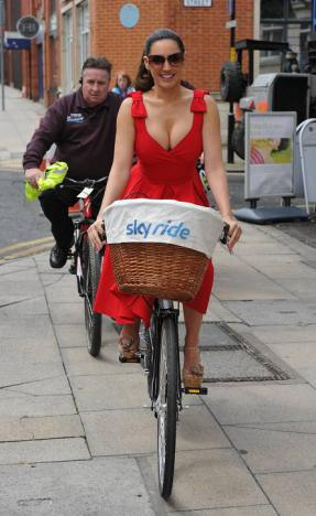 Kelly Brook  riding bike in sexy red dress