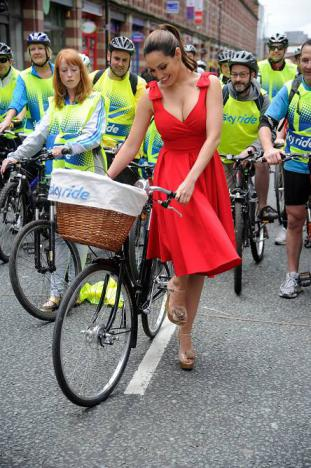 Kelly Brook Gets off bike