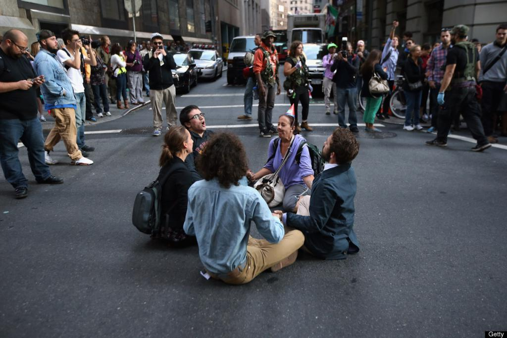 Peaceful protesters sit in the street