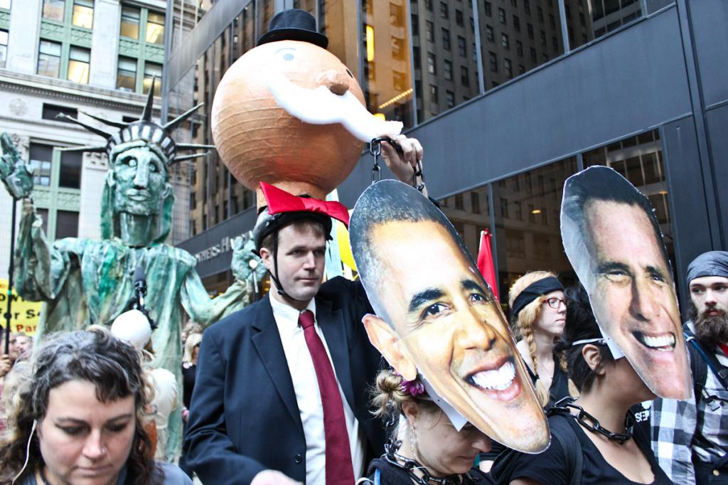 crowd with giant Obama And Romney faces