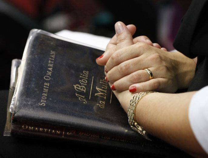 Holding Hands on the bible