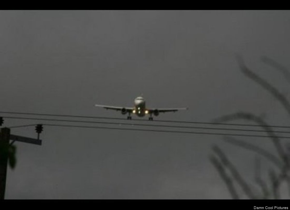 Plane Above telephone wires