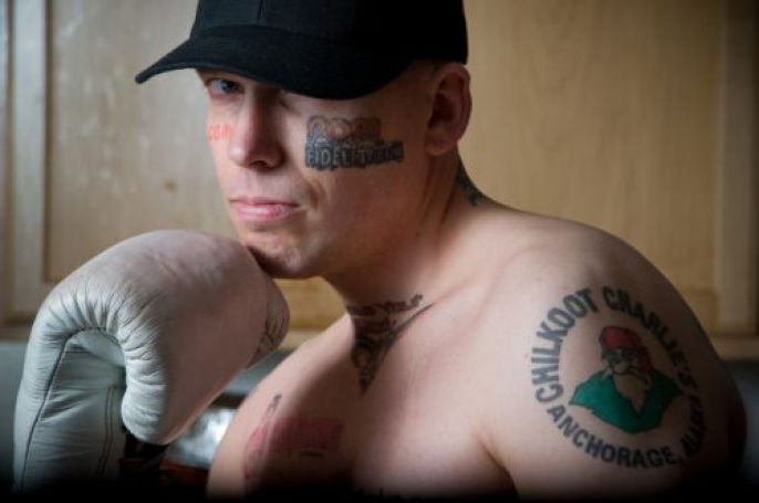 Tattoos and boxing glove