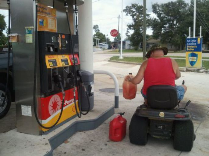 Lawn Mower Gas Station Fill Up