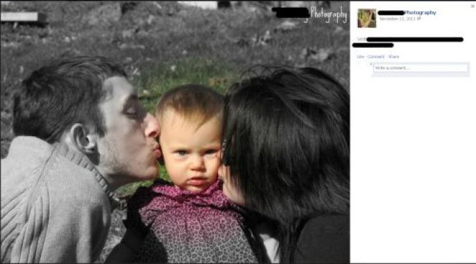 couple kissing the child
