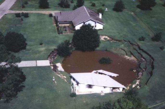 House in large Sinkhole