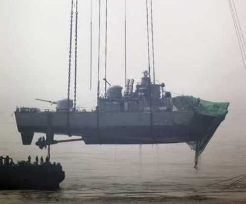 Crane Lifting Navy Vessel