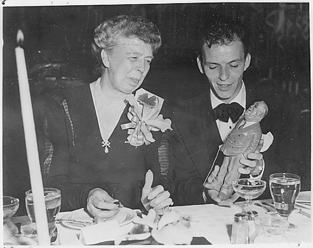 Eleanor Roosevelt with an figurine of FDR held by Frank Sinatra