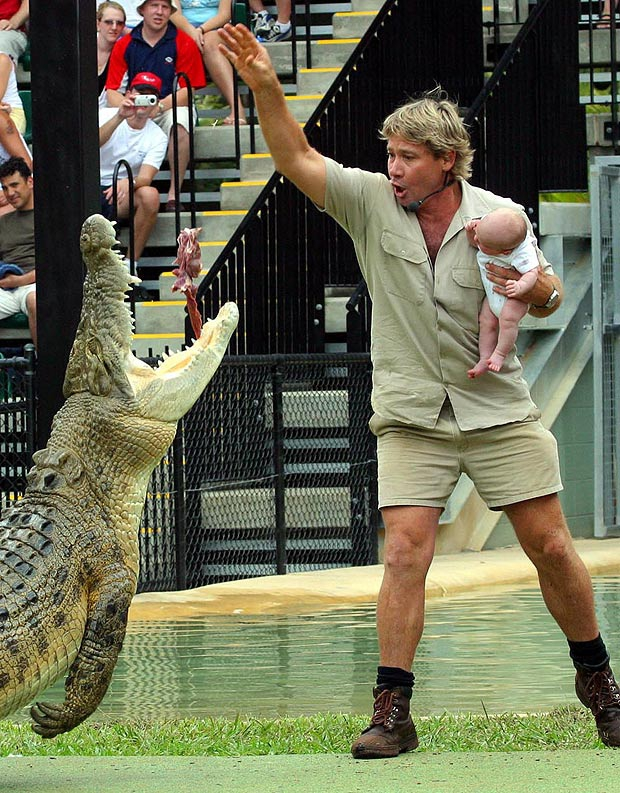 Steve Irwin Holding His Son Next To The Action