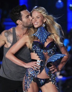 Adam Levine Stealing a Kiss from one of the angels.