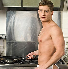 Sexy Happy Men Cooking in the Kitchen
