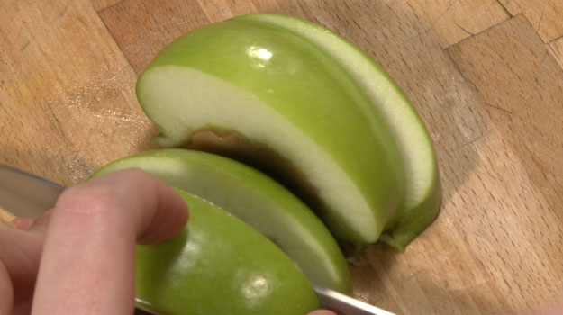 To serve, place apples jello-down on cutting board. Slice in half, then in half again.