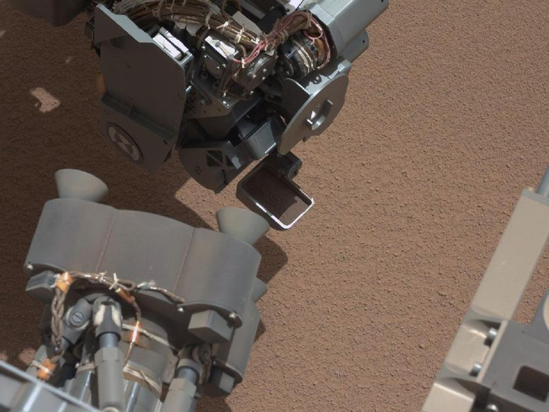 Curiosity Stars Taking Samples of Soil