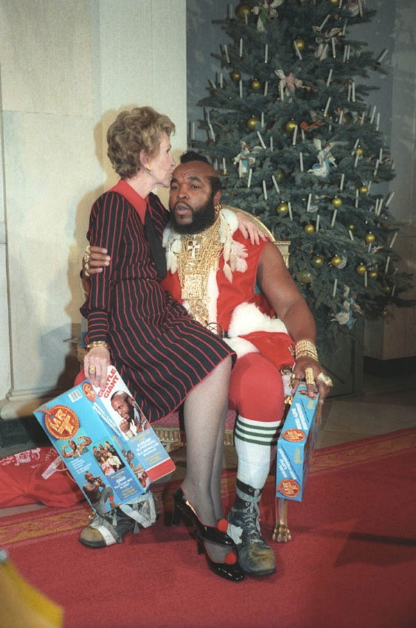 Nancy Reagan sitting on Mr. T's lap (and kissing his head!)
