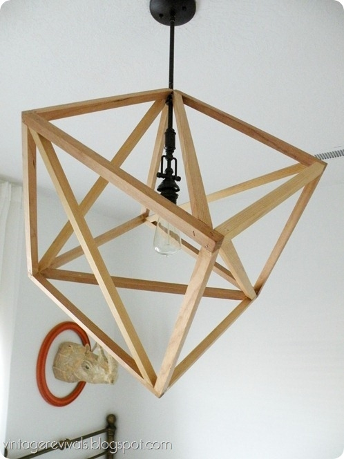 Use pieces of wood to make a cube light.