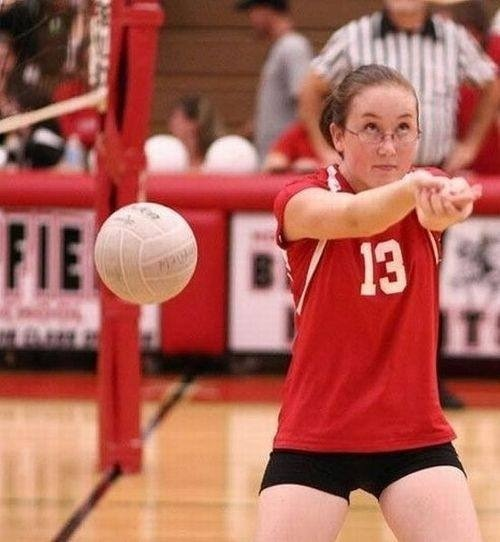 Playing volleyball. Keep your eye on the ball kid!!!