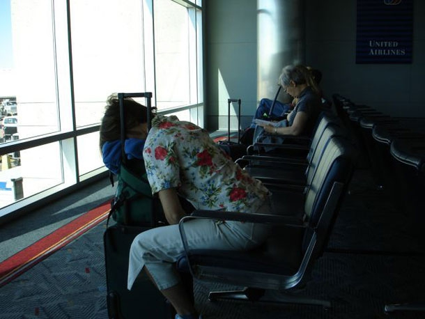 Awkward Sleeping Positions Of People At Airports