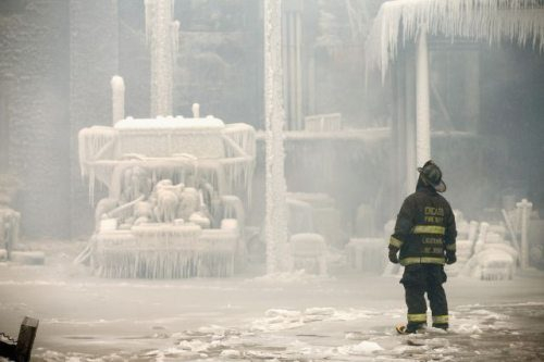 Chicago Firemen put out fire in the icy cold