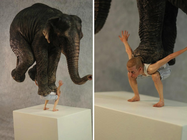 Tiny Man Precariously Balances an Elephant on His Back
