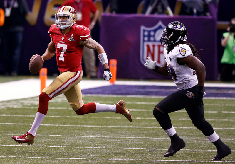 Colin Kaepernick runs a keeper as Baltimore Ravens' Dannell Ellerbe pursues during the fourth quarter