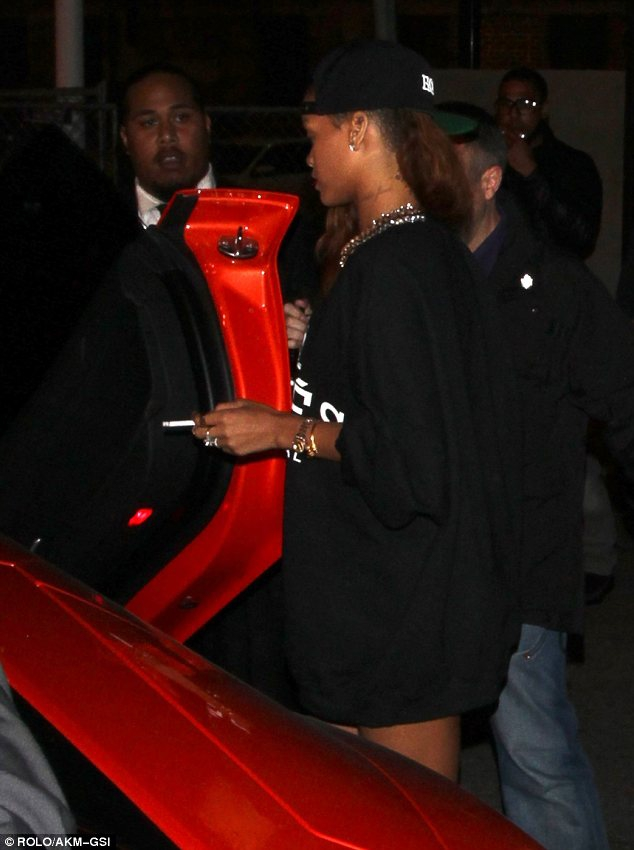 Rihanna heads to a club in just a jumper