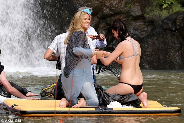 Heidi Klum keeps her beach body under wraps