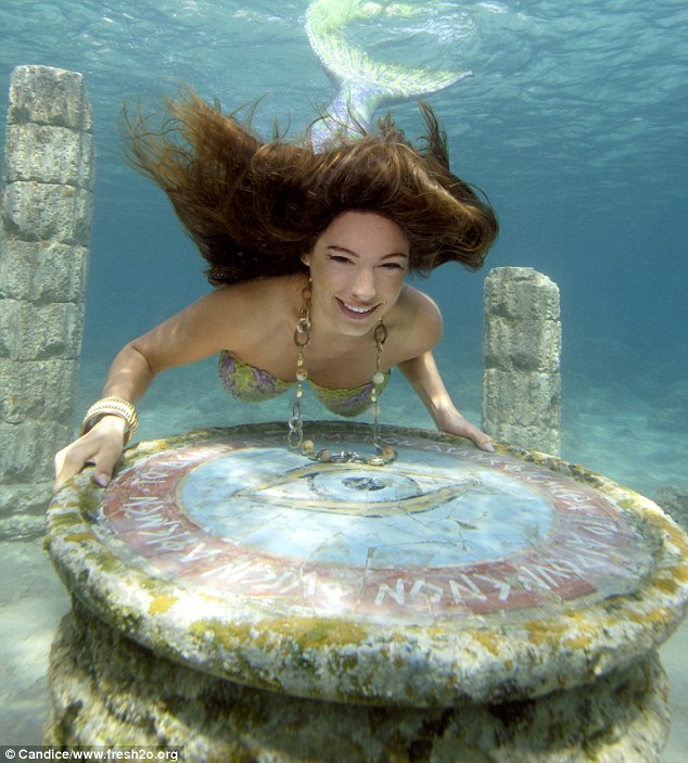 Kelly Brook Poses under Water in Mermaid Costume