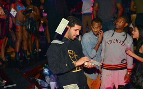 Drake makes it rain in the strip club, but why…