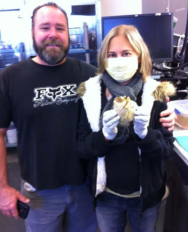 Penny Smith and her husband with Penny's old heart.