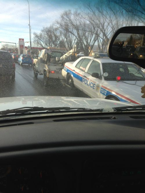Towed Cop Car