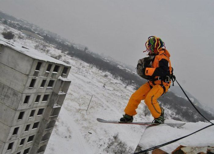 Snowboarder About To Take A Leap Of Faith