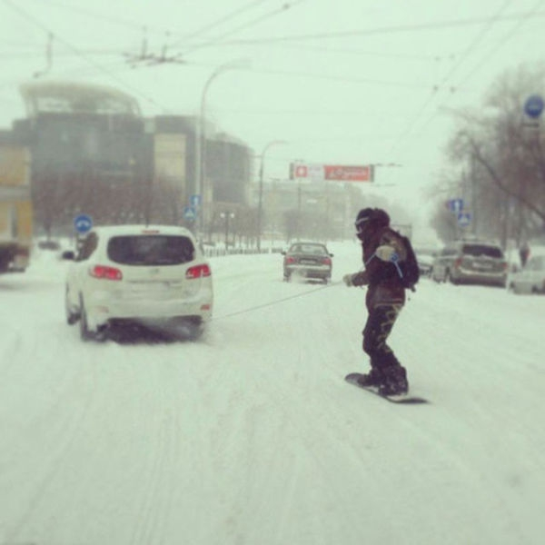 Dragging A Snowboarder Behind A Car