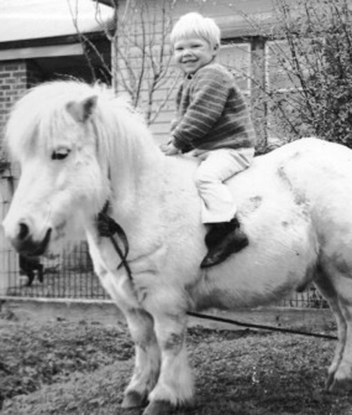Happy boy on horse