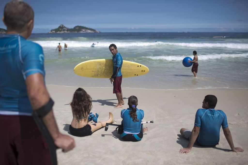 Disabled Surfers  get a lesson