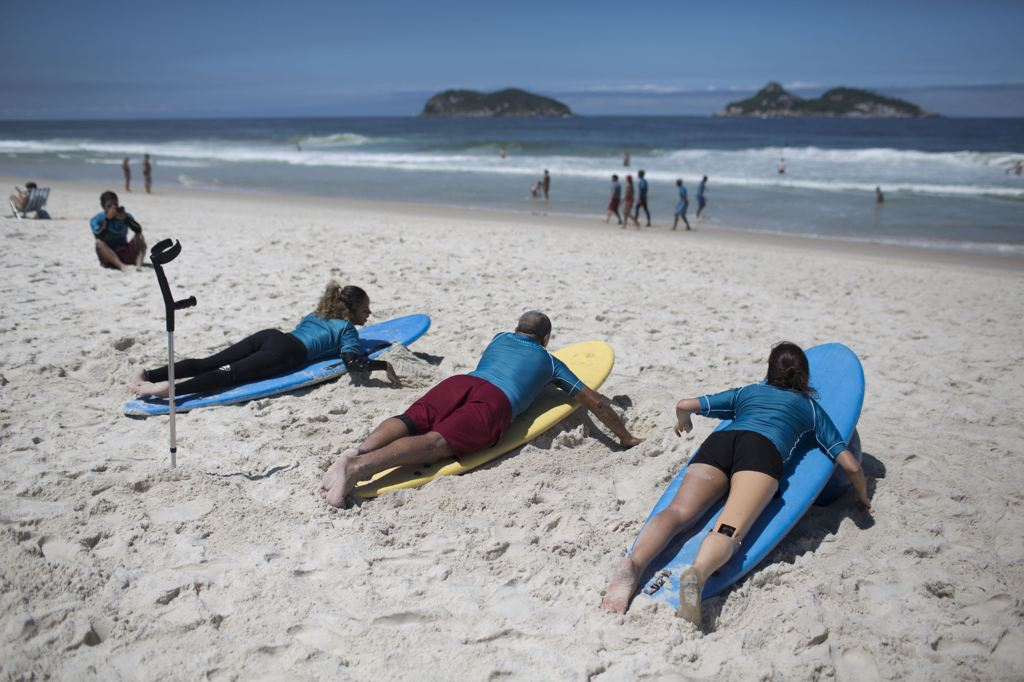 Disabled Surfers Practice before hitting the waves