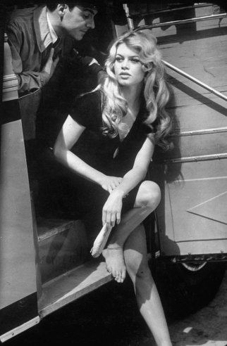 Brigitte Bardot exiting a car