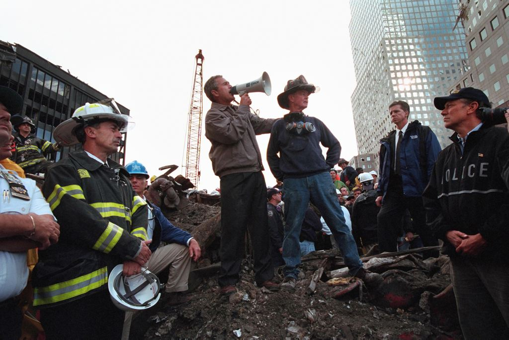 George Bush at his first trip to ground zero