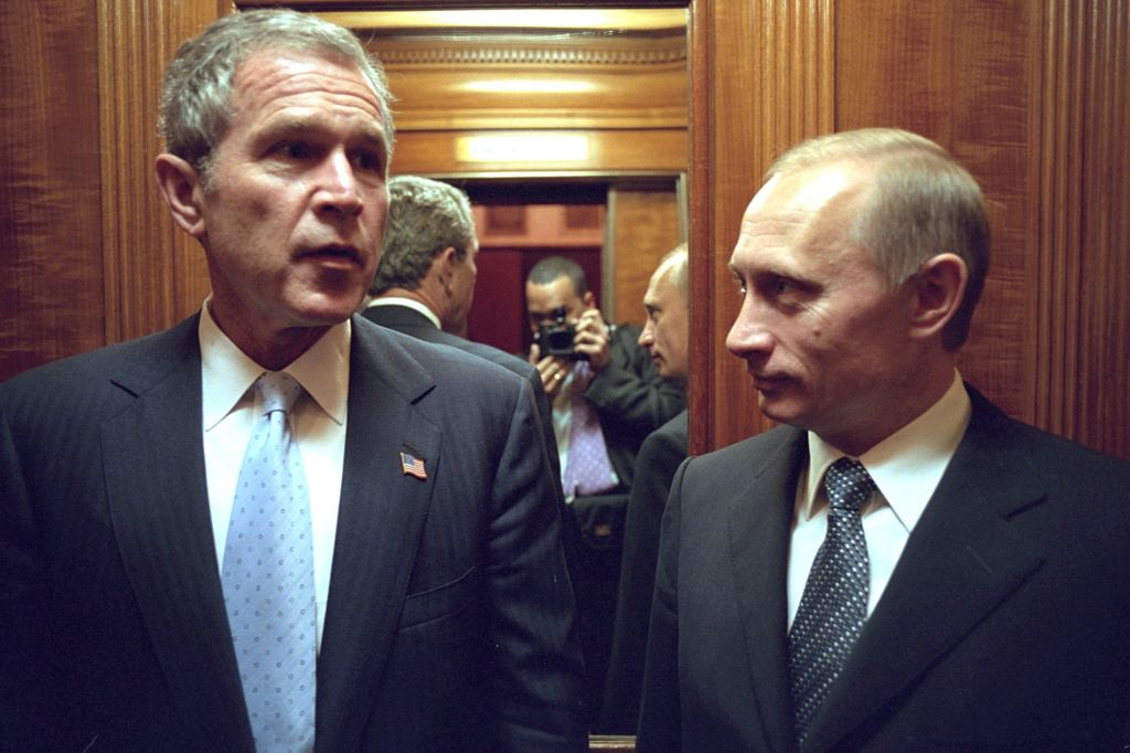Eric Draper Caught a picture of himself in this photo of Bush and  Russian President Vladimir Putin