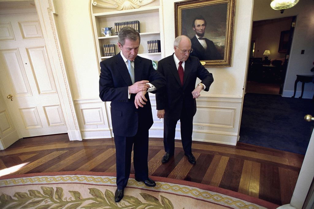 George W. Bush and Dick Cheney Check the time