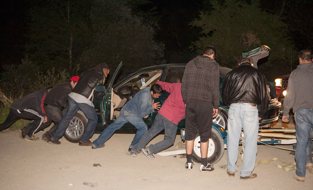Family members and friends prepare to tow the vehicle of missing hikers Nicholas Cendoya, 19, and Kyndall Jack, 18