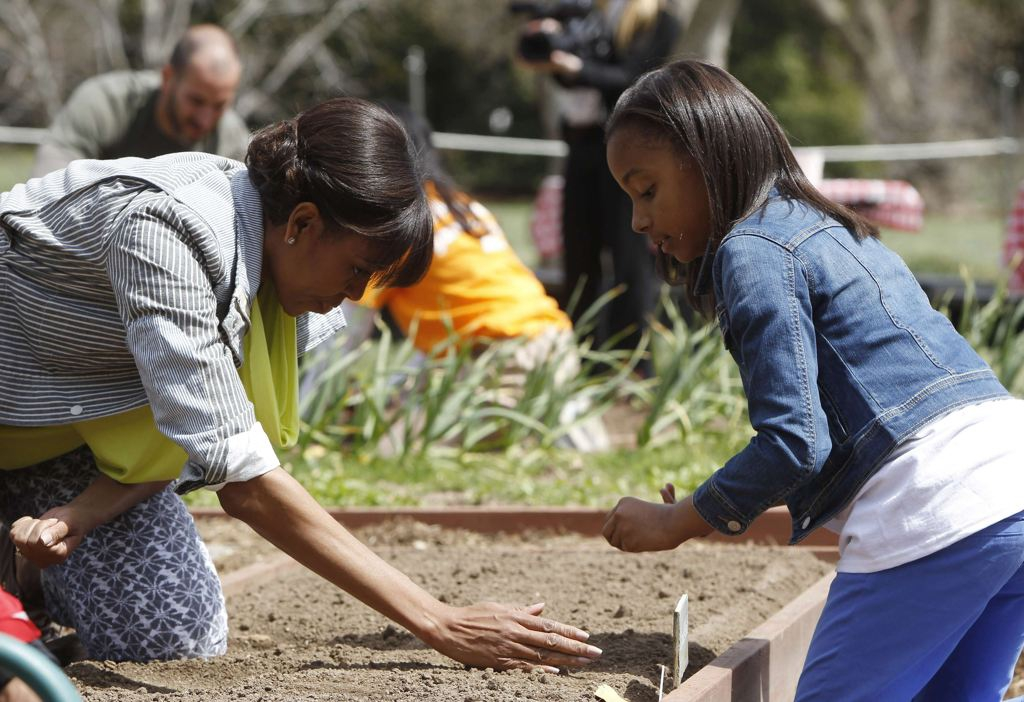 Michelle Obama Planting veggies