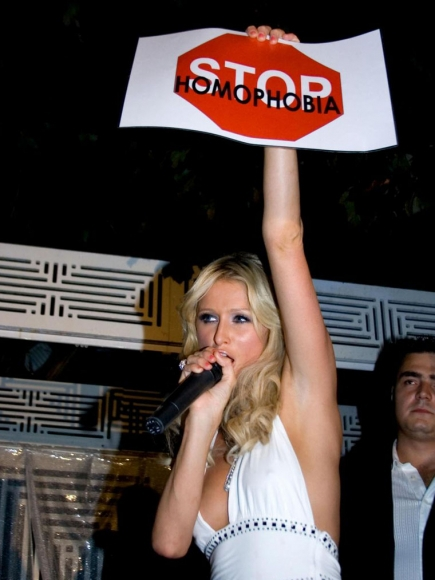 Paris Hilton Holding Stop Homophobia Sign In Milan