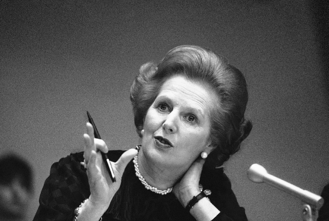 Thatcher Gesturing at a conference