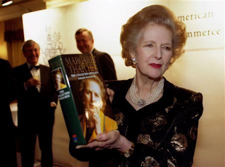 Margaret Thatcher poses with a copy of her new book
