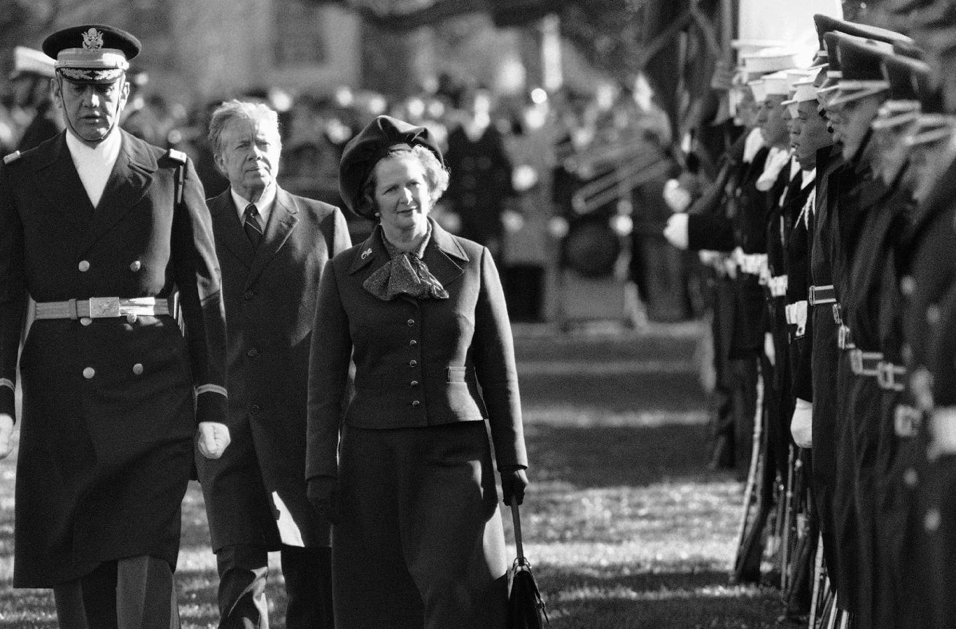 British Prime Minister Margaret Thatcher reviews the honor guard at the White House