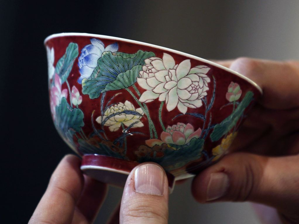 "A magnificent Ruby-Ground Falangcai ""Double-Lotus"" Bowl Blue Enamel Yuzhi Mark and Period of Kangxi is shown after Hong"