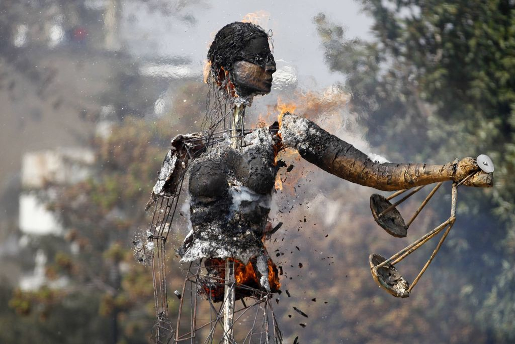 "A sculpture depicting ""The Justice"" is seen on fire"