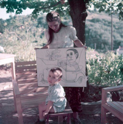 Françoise Gilot, Picasso's lover for 10 years, with their young son, Claude. She holds drawings of the boy by Picasso.