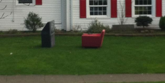 TV and chair on front lawn