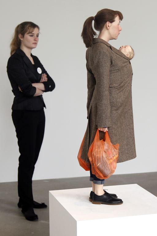 "A visitor looks at a sculpture entitled ""Woman with Shopping, 2013"""